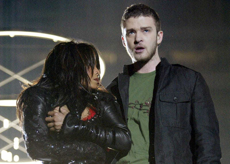 Janet Jackson and Justin Timberlake perform during the halftime show at Super Bowl 38 between the New England Patriots and the Carolina Panthers at Reliant Stadium in Houston on Feb. 1, 2004. At the end of the performance, Timberlake tore away a piece of Jackson's outfit. (Frank Micelotta/Getty Images)