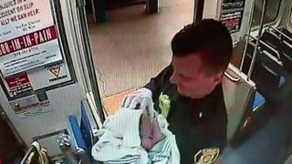 Paramedics hold a baby who was born on a Philadelphia subway train Christmas Day.SEPTA