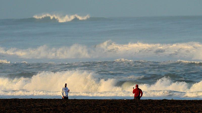 Onlookers at a beach in California in 2011, after the Fukushima earthquake triggered tsunami warnings. Photo: AP
