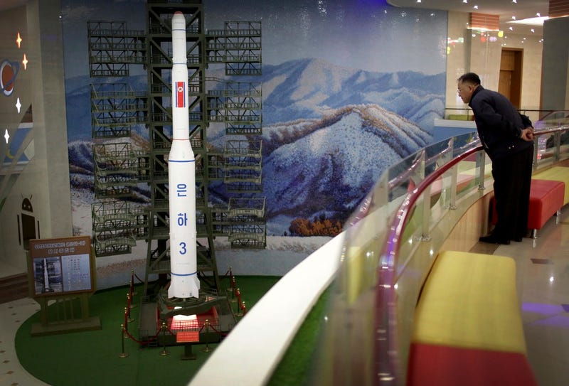 A North Korean man looks at a model of the Unha 3 space launch vehicle displayed at the Mangyongdae Children's Palace in Pyongyang on April 14, 2017 (AP Photo/Wong Maye-E)