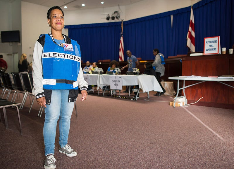 Election official Cassandra Lewis waits to welcome voters at an early-voting poll station in Washington, D.C., on Oct. 25, 2016. ANDREW CABALLERO-REYNOLDS/AFP/Getty Images