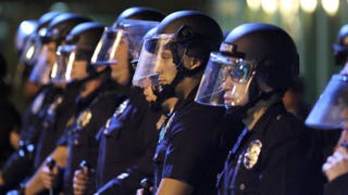 Police officers line up to protect the LAPD headquarters Nov. 25, 2014, in Los Angeles as they face off with protesters after the grand jury decision not to indict Officer Darren Wilson, who shot dead unarmed teen Michael Brown in Ferguson, Mo.David McNew/Getty Images