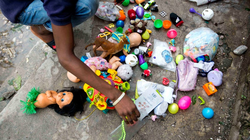 A man dries his toys after he recovered them from the debris left by Hurricane Matthew in Les Cayes, Haiti, Thursday, Oct. 6, 2016. Two days after the storm rampaged across the country's remote southwestern peninsula, authorities and aid workers still lack a clear picture of what they fear is the country's biggest disaster in years.