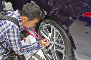 Illustration for article titled Is this guy an auto-spy at Geneva Auto Show?