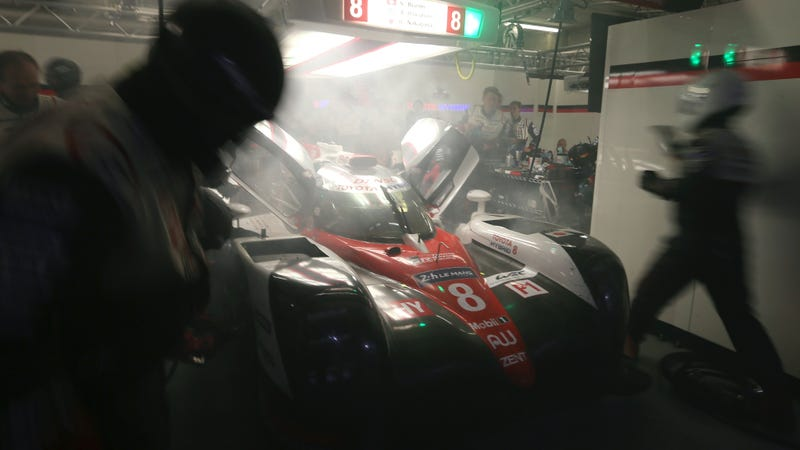The No. 8 goes into the garage still smoking a bit from hybrid problems encountered during the race. Photo credit: David Vincent/AP Images
