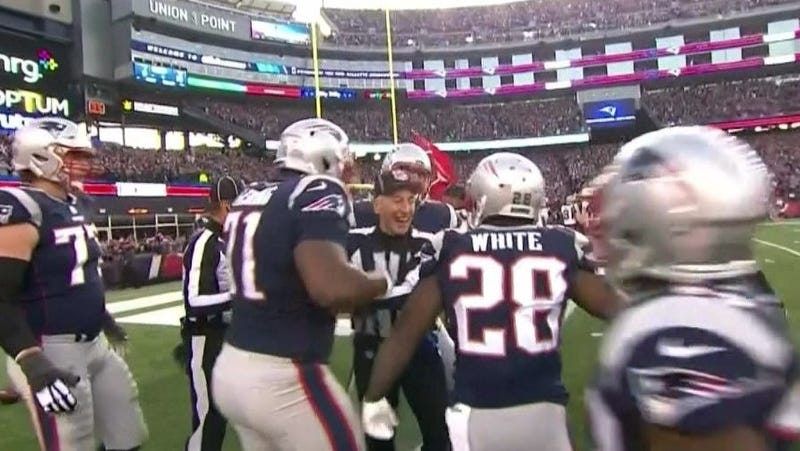 An NFL referee celebrates with New England Patriots players after the Patriots score the game-winning touchdown on Jan. 21, 2018. (CBS screenshot)