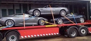 Illustration for article titled This Is The Most Heinous Way To Transport Aston Martins You'll Ever See