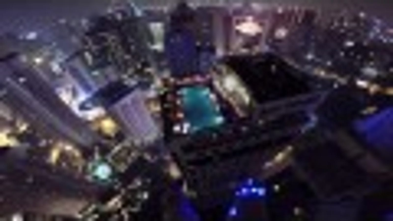 Watch This BASE Jumper Parachute Into a Rooftop Pool