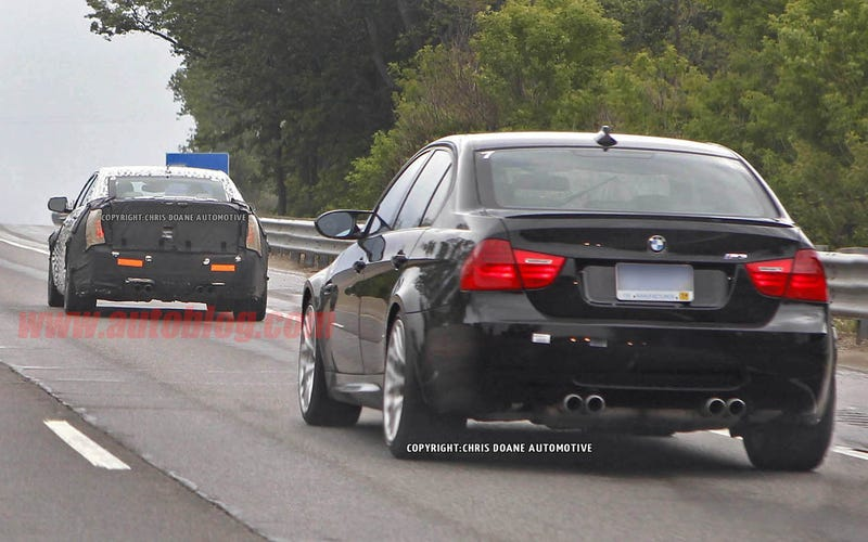Illustration for article titled 2015 Cadillac ATS-V Caught Testing with BMW M3 E90