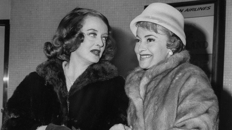 Bette Davis (left) and Olivia De Havilland arrive at Kennedy Airport to attend the opening of Hush, Hush, Sweet Charlotte in New York. (Photo: Joe Farrington/NY Daily News Archive/Getty Images)