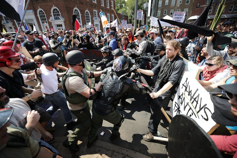 White nationalists, neo-Nazis and members of the 'alt-right' clash with counter-protesters as they enter Emancipation Park during the 'Unite the Right' rally August 12, 2017 in Charlottesville, Virginia.