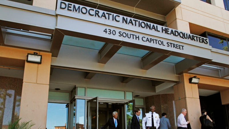 In this June 14, 2016 file photo, people stand outside the Democratic National Committee (DNC) headquarters in Washington.