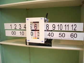 Illustration for article titled Slide-Rule Clock Will Match Your Mathcamp Trophy