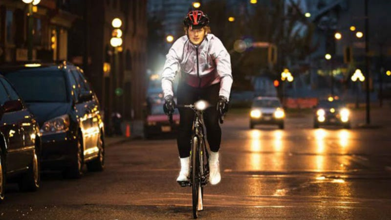 "Illustration for article titled This Bike Jacket Uses Embedded Glass ""Pixels"" to Light Up the Night"