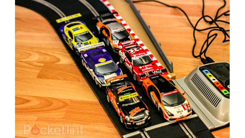 Illustration for article titled Impossible Slot Car Track Lets You Race More Than Two Cars At Once