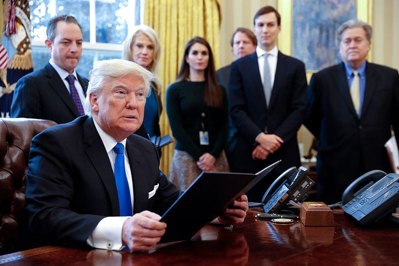 President Donald Trump on Jan. 24, 2017, in the Oval Office of the White House in Washington, D.C. Behind him are former White House chief of staff Reince Priebus, counselor to the president Kellyanne Conway, soon-to-be-former White House Communications Director Hope Hicks, maybe soon-to-be-former senior adviser Jared Kushner (second from right) and former senior counselor Stephen Bannon.