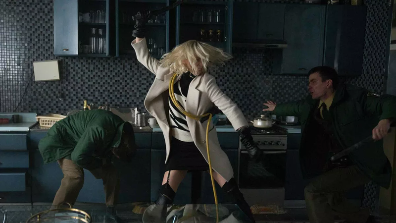 Charlize Theron, beating folks up.