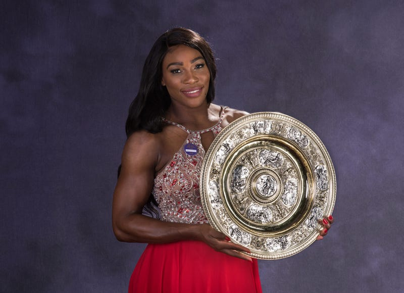 Wimbledon ladies singles tennis champion Serena Williams  poses with the trophy at the Wimbledon Champions Dinner in London July 10, 2016.  Bob Martin/AELTC/Pool/Getty Images
