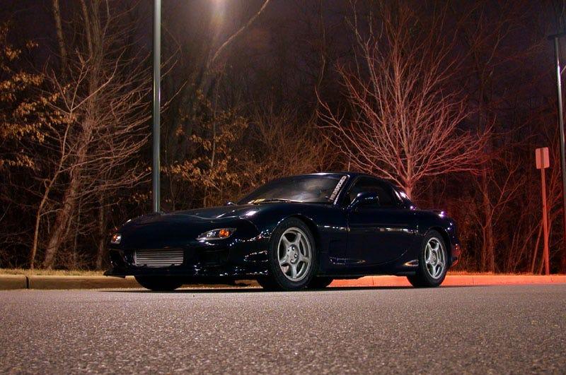 A beautiful black Mazda RX-7 of the FD generation.