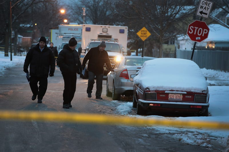 Police investigate the scene of a quadruple homicide on Chicago's South Side on Dec. 17, 2016.Scott Olson/Getty Images