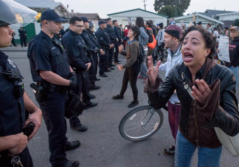 Kimalah Luguarre cries and yells at police officers during an anti-police-brutality march in Oakland, Calif., on Jan. 17, 2015. About 100 protesters disrupted traffic and chanted as they made their way to the Oakland Police Station, where at least five people were arrested. Josh Edelson/AFP/Getty Images