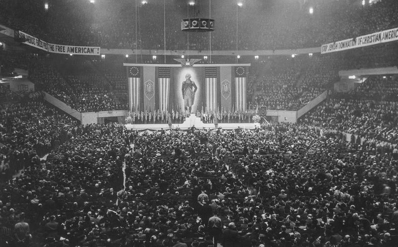 """Nazi rally of German-Americans held at Madison Square Garden on February 20, 1939, including a sign that reads """"Stop Jewish Domination of Christian Americans"""""""