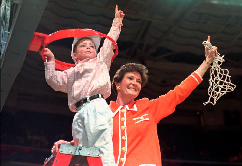 Summitt and son Tyler cut down the net after winning the championship in 1996. (Pat Sullivan/AP Images)