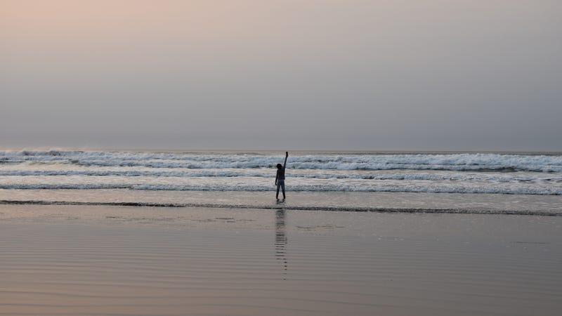 Bravo measuring windspeed at the beach. Photo: Tammy Bravo