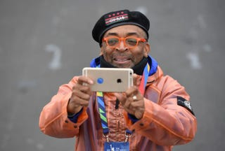 Movie director Spike Lee takes photos of the elite runners during the TCS New York City Marathon Nov. 1, 2015. Lee was the event's grand marshal.DON EMMERT/AFP/Getty Images