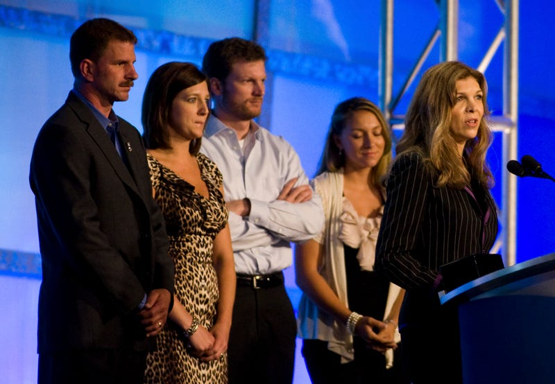 The Earnhardt family at the NASCAR Hall of Fame Induction Ceremony for Dale Earnhardt Sr., with Teresa Earnhardt speaking. Kerry Earnhardt, Kelley Earnhardt, Dale Earnhardt Jr. and Taylor Earnhardt stand behind. Photo credit: Chris Keane/Stringer/Getty Images