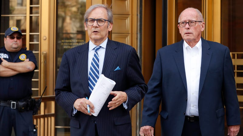 Former Rochester Drug Co-Operative CEO Laurence Doud III, right, leaving U.S. District Court in Manhattan with his attorney Robert C. Gottlieb, center, on April 23, 2019.