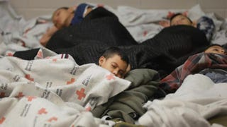 Detainees sleep in a holding cell at a U.S. Customs and Border Protection processing facility on June 18, 2014, in Brownsville,Texas. Brownsville and Nogales, Ariz., have been central to processing the more than 47,000 unaccompanied children who have entered the country illegally since Oct. 1.Eric Gay-Pool/Getty Images
