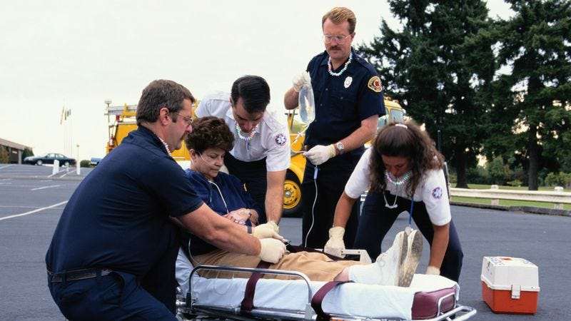 Illustration for article titled True Heroes: These Paramedics Wear Candy Necklaces For Injured People To Eat As They're Carried To Safety