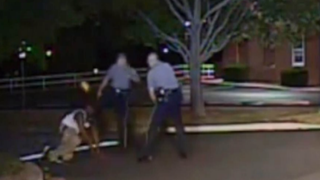 Dash-cam video footage of an August 2013 incident shows Dover, Del., Police Cpl. Thomas Webster IV kicking Lateef Dickerson in the face. Dickerson suffered a broken jaw.NBC News Screenshot