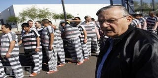 Maricopa County Sheriff Arpaio stands with prisoners. (Google)