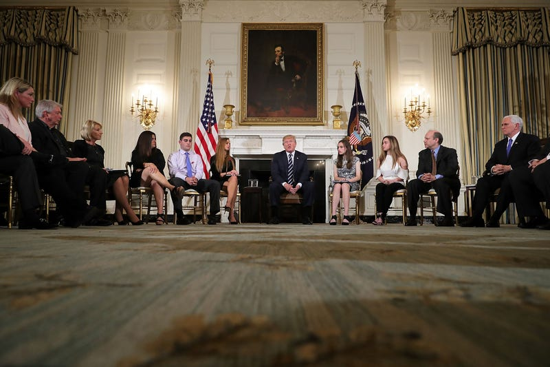 President Donald Trump (center) holds a listening session with student survivors of mass shootings, their parents and teachers in the State Dining Room at the White House  in Washington, D.C.. on Feb. 21, 2018. (Chip Somodevilla/Getty Images)