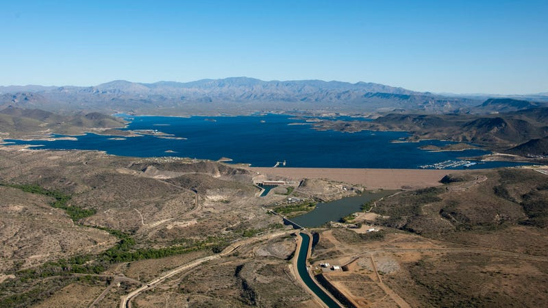 Energy harvested from evaporation can reduce half the amount of water lost to natural evaporation, according to new research. Water-strapped cities with growing populations and energy needs could benefit most, including greater Phoenix which is served by the above reservoir and irrigation system fed by the Colorado River. (Image: Central Arizona Project)