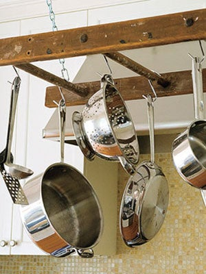 Illustration for article titled Repurpose an Old Ladder Into a Pot Rack
