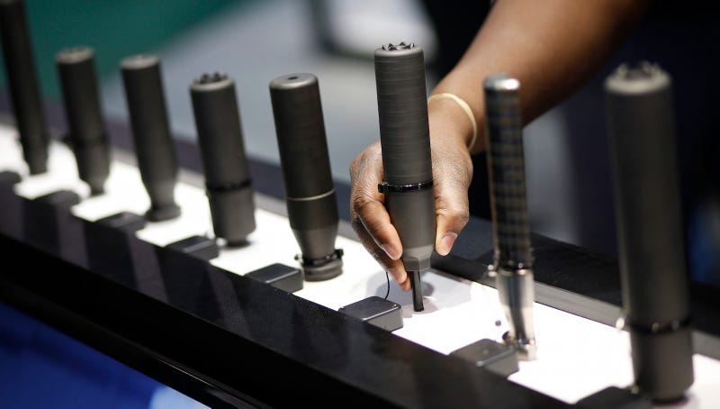 Silencers on display at a gun show in Las Vegas, NV. Image via AP Photo.
