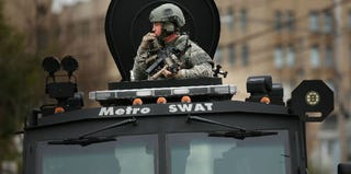 SWAT team patrols a Watertown, Mass., neighborhood during the hunt for Boston bombing suspects. (Spencer Platt/Getty Images)