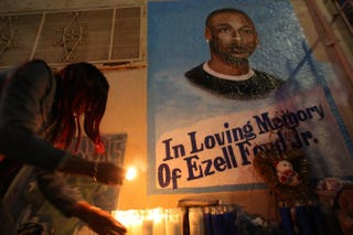 Tritobia Ford lights candles Dec. 29, 2014, in Los Angeles at a memorial for her son, Ezell Ford, a 25-year-old mentally ill man, at the site where he was shot and killed by two LAPD officers.David McNew/Getty Images