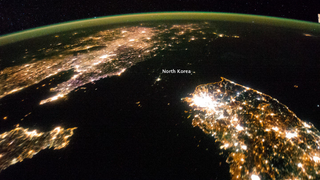 Illustration for article titled North Korea seen from space reveals a country living in the dark