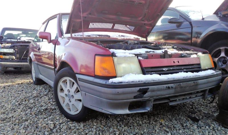 Illustration for article titled Junkyard Gems: 1990 Ford Escort GT 1.9 HO