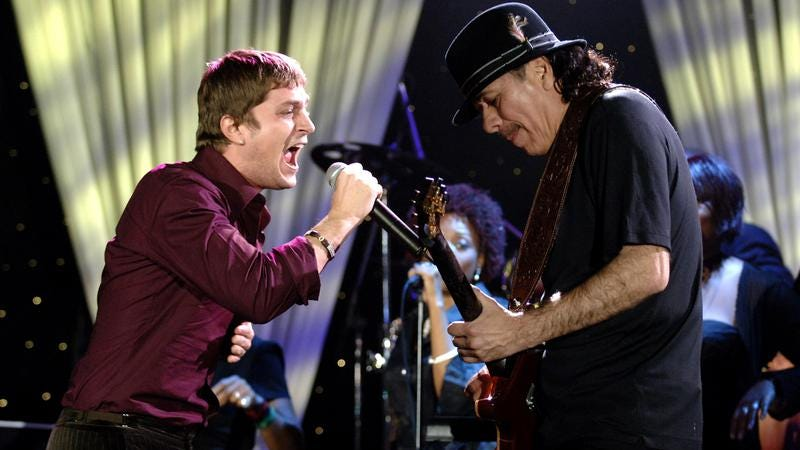 Rob Thomas and Santana, sadists (Photo: L. Busacca/WireImage via Getty)