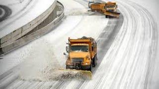 Snowplows clean lanes on Interstate 75/85 in Atlanta.    Youtube