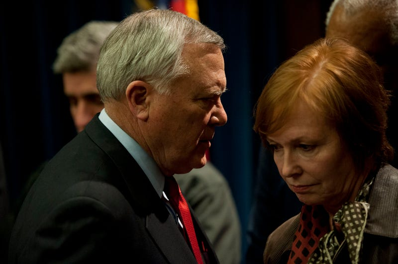 Georgia Gov. Nathan Deal talks to Brenda Fitzgerald, then-commissioner of the Georgia Department of Public Health, during a news conference at the Capitol on Feb. 11, 2014, in Atlanta. (Davis Turner/Getty Images)