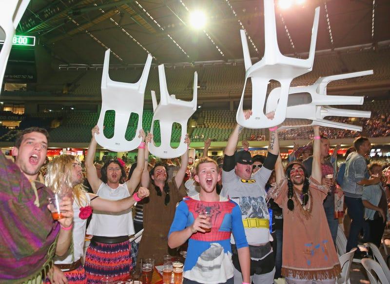 Illustration for article titled Rioting Costumed Fans Halt Australian Darts Competition