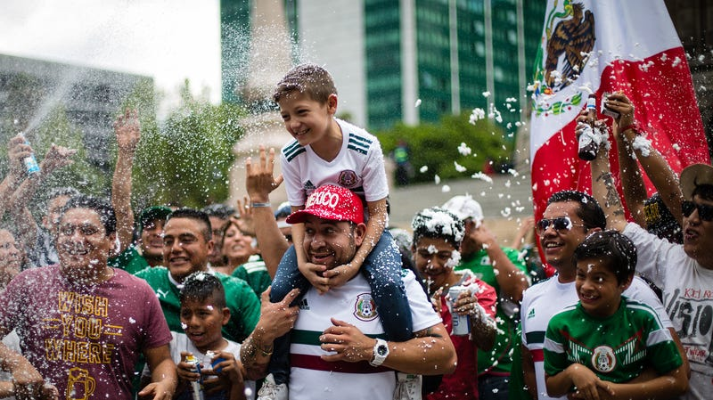 Fans in Mexico City celebrate their team's 1-0 win over Germany in the World Cup.