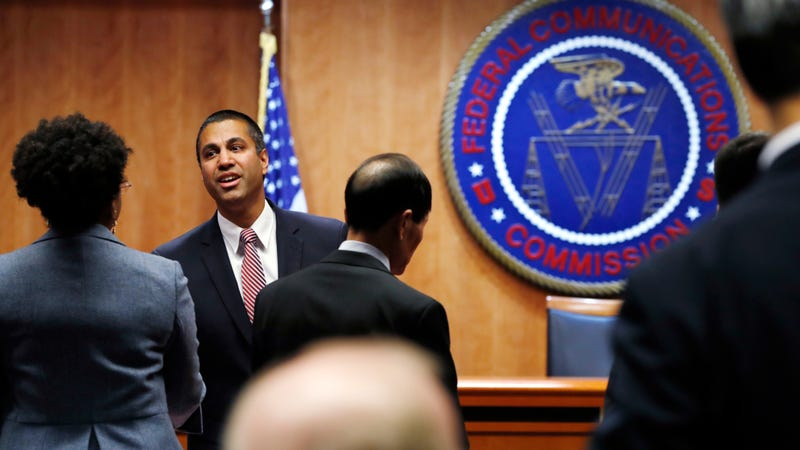 Federal Communications Commission (FCC) Chairman Ajit Pai, left, greets witnesses before the meeting where the FCC voted to repeal net neutrality, Dec. 14, 2017, in Washington.