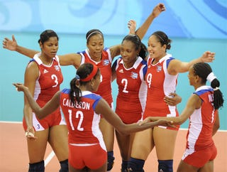 Cuban Players Celebrate Their Win Against Serbia In The Womens Volleyball Quarterfinal Match At 2008 Beijing Olympic Games On August 19